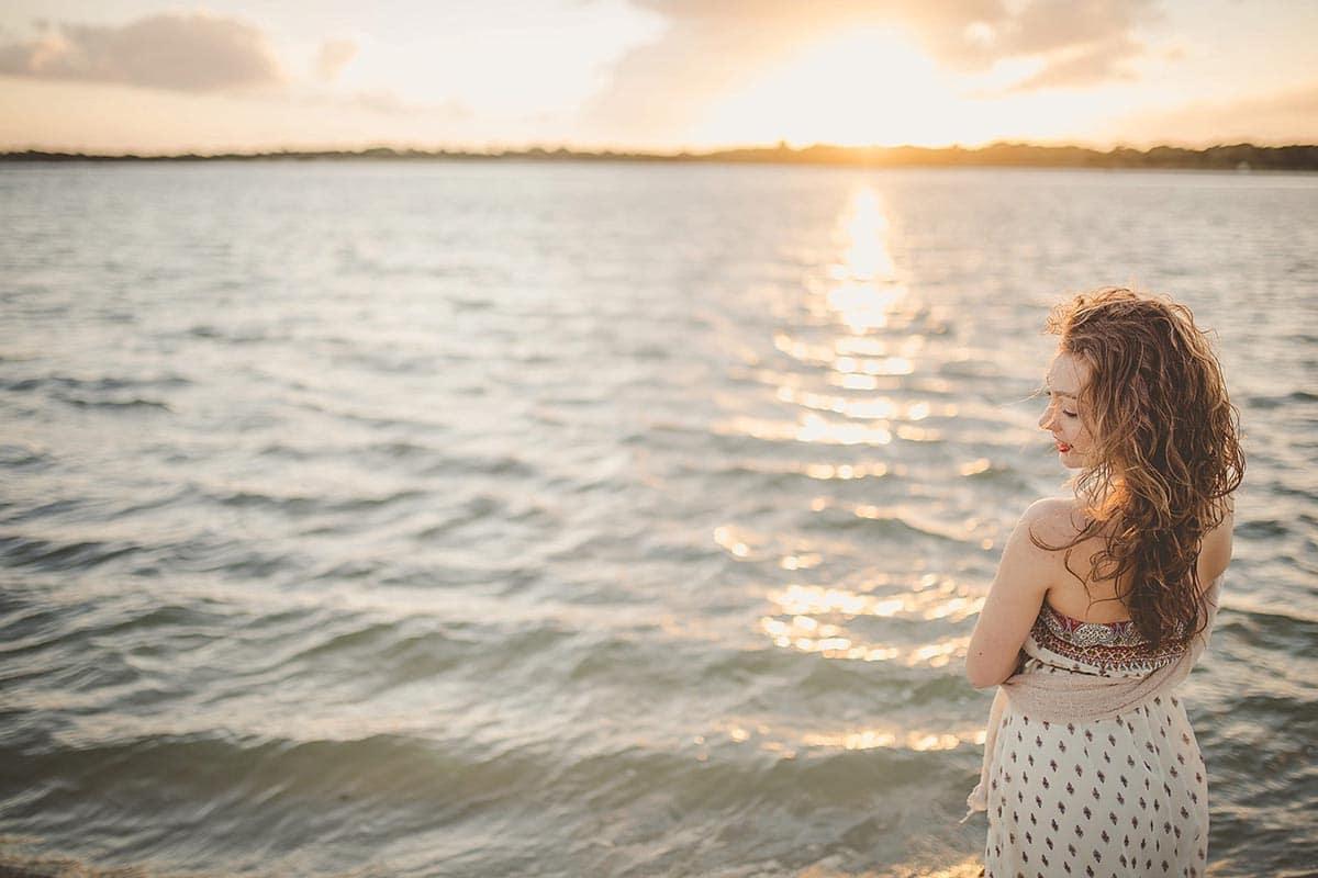 Girl on Beach Looking at Ocean