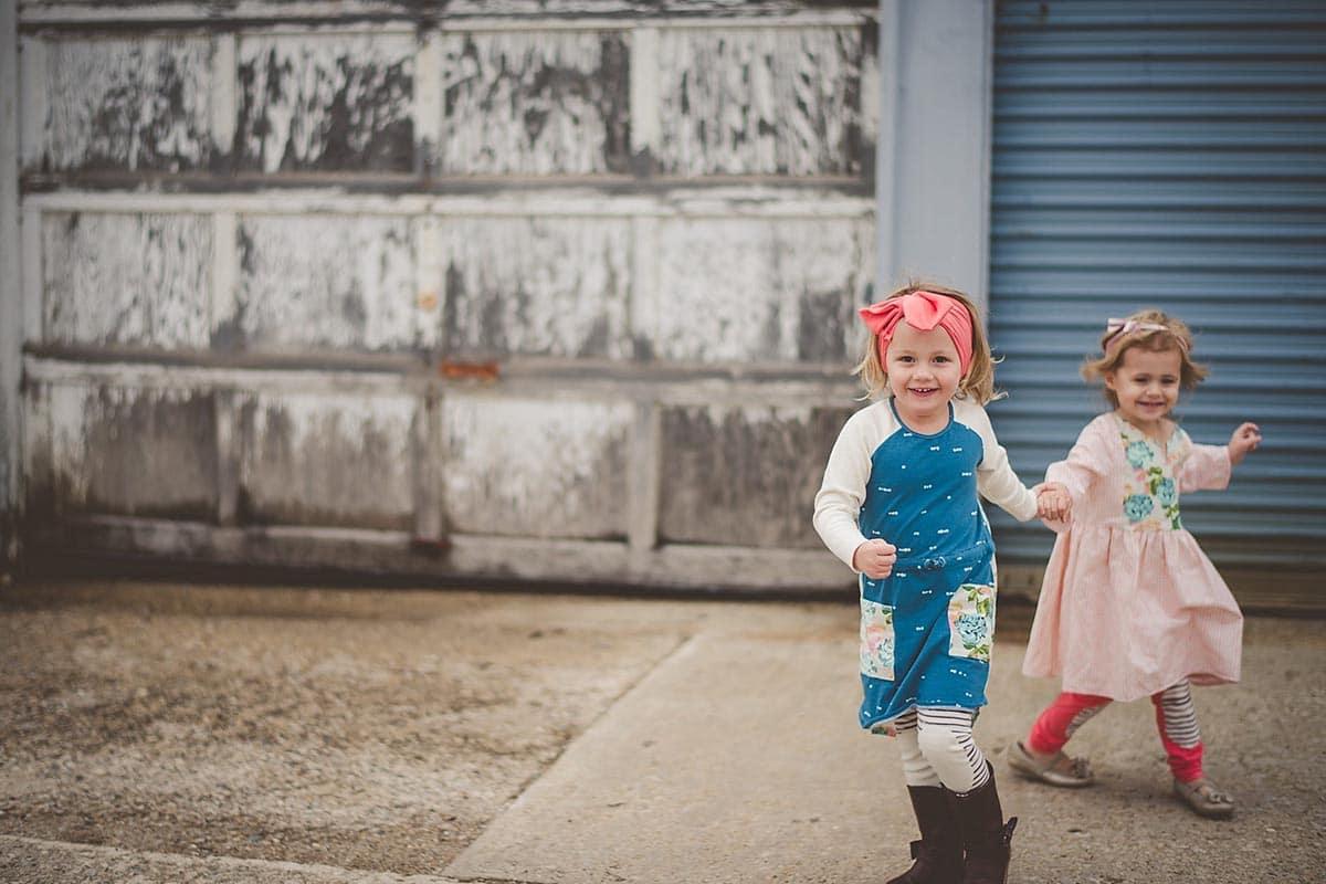 Little Girls Holding Hands Running