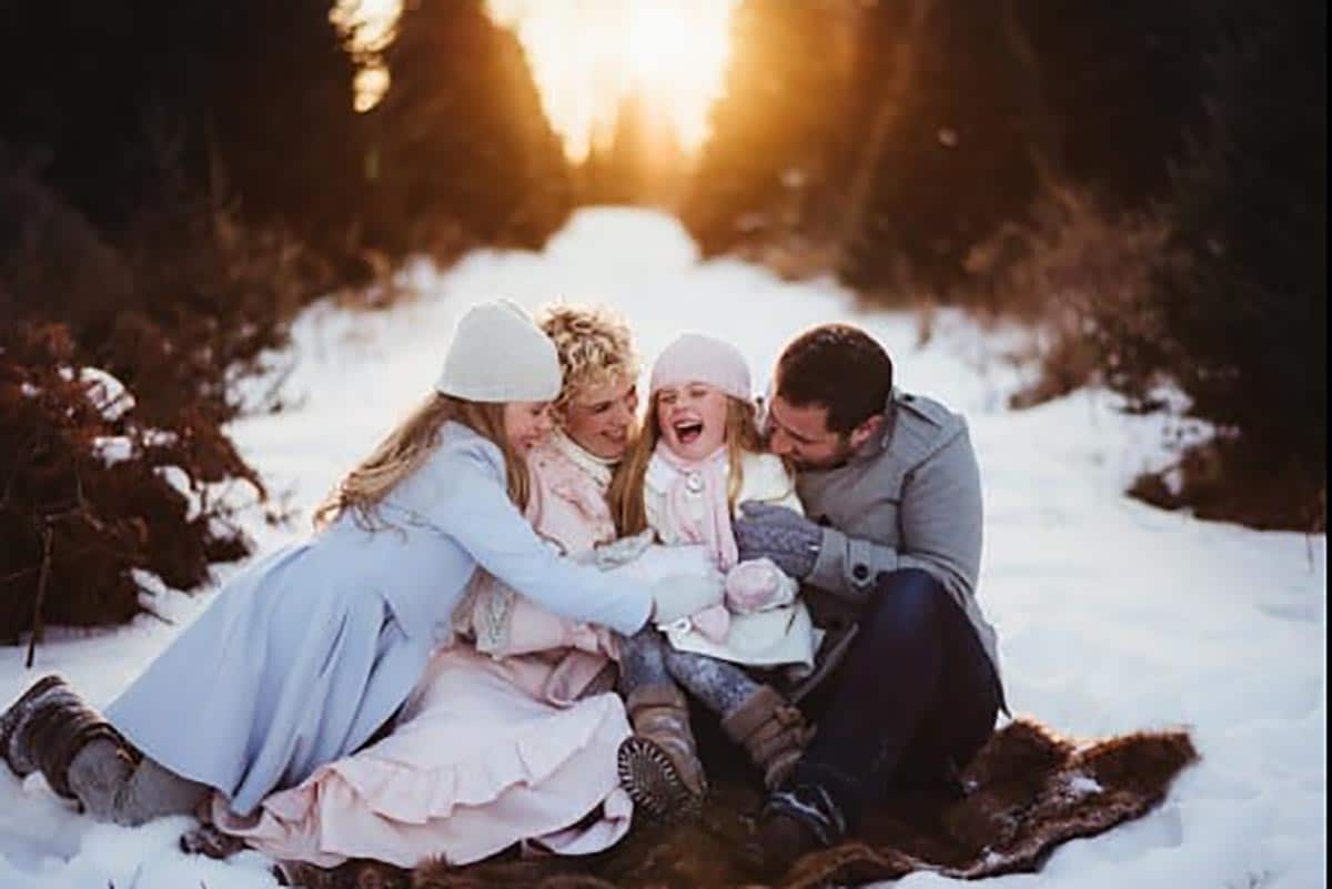 Family in Snow at Sunset