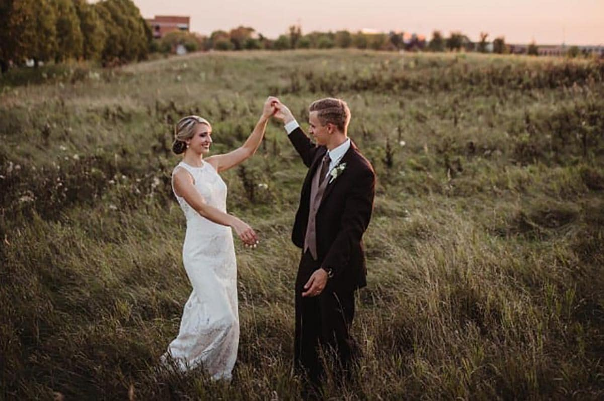 Bride Groom Dancing in Field