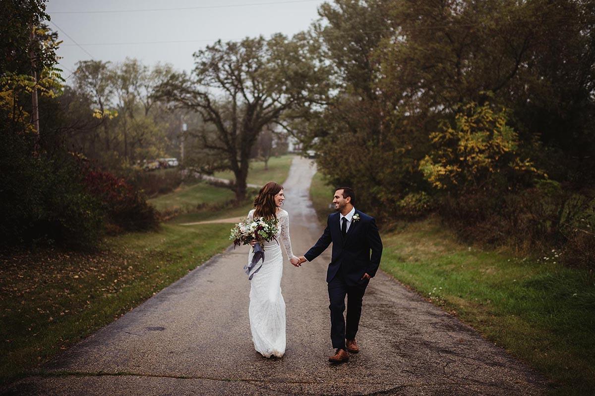 Bride Groom Holding Hands on Street