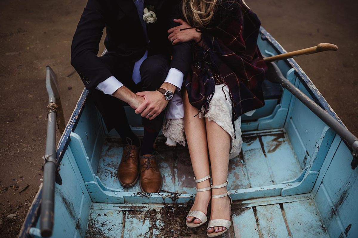 Bride Groom in Boat on Water