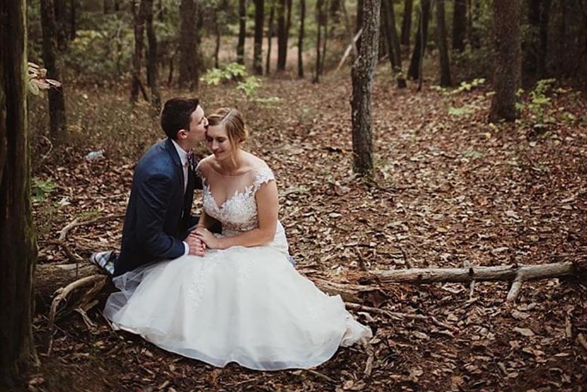 Bride Groom in Woods on Log