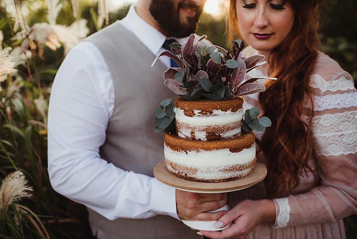 Bride Groom Holding Cake
