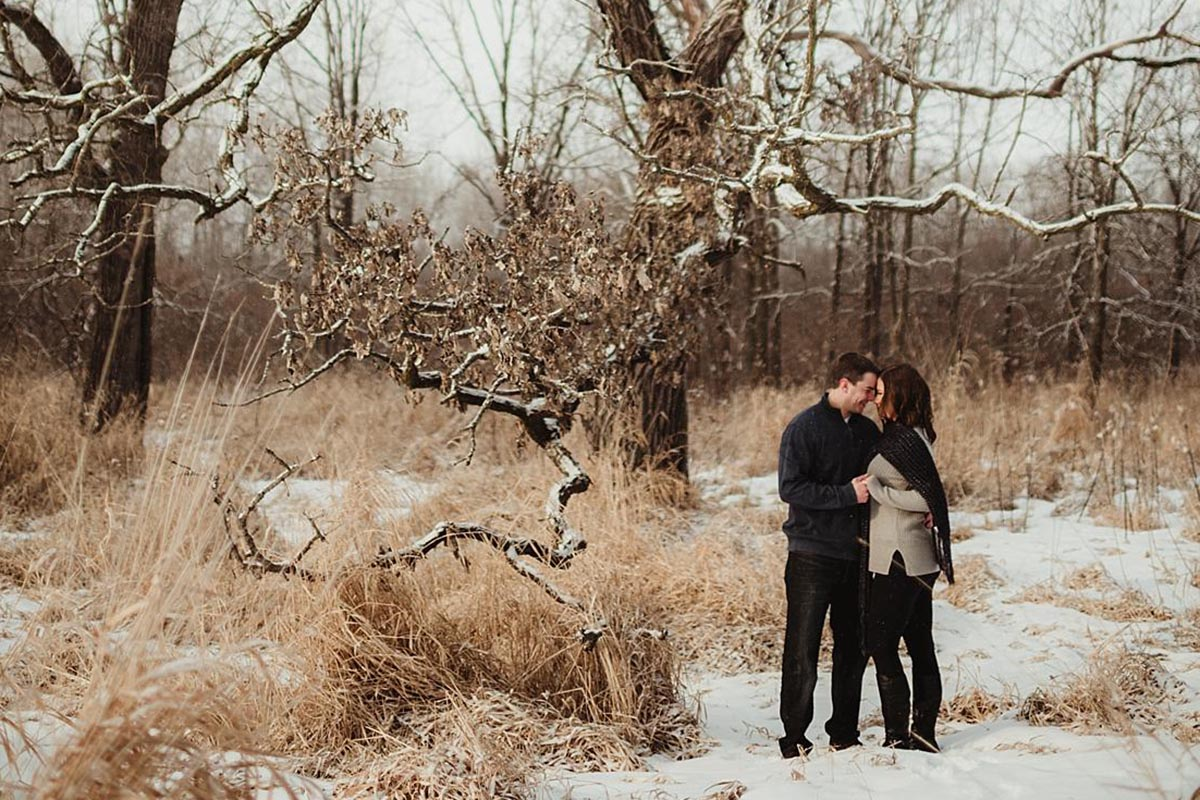 Engagement Couple Near Trees in Winter