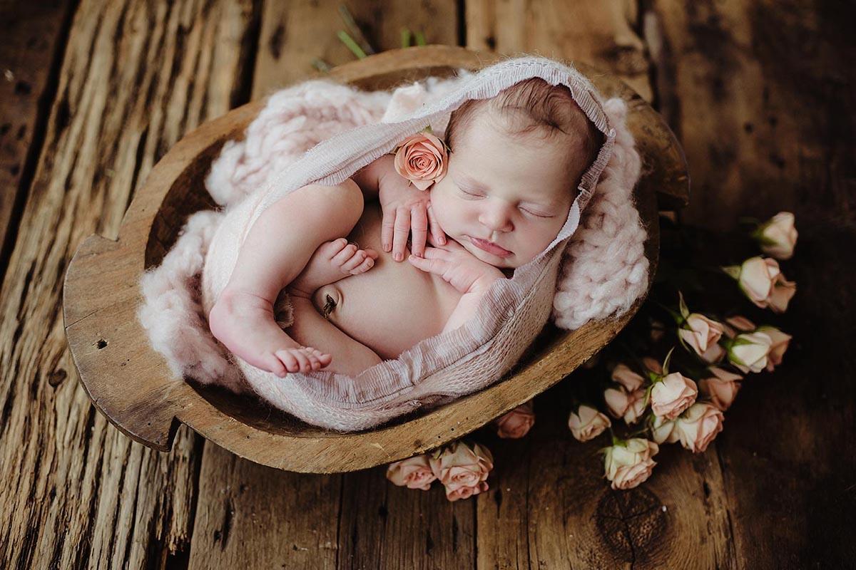 Newborn Girl in Wood Bowl
