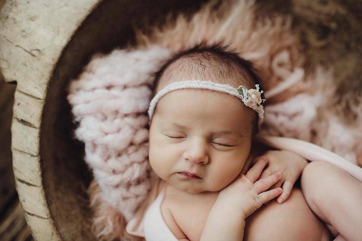 Newborn Girl in Pink Wrap and Headband