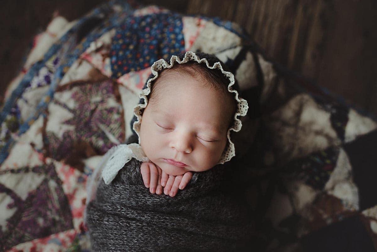 Newborn Girl in Grey Bonnet and Wrap
