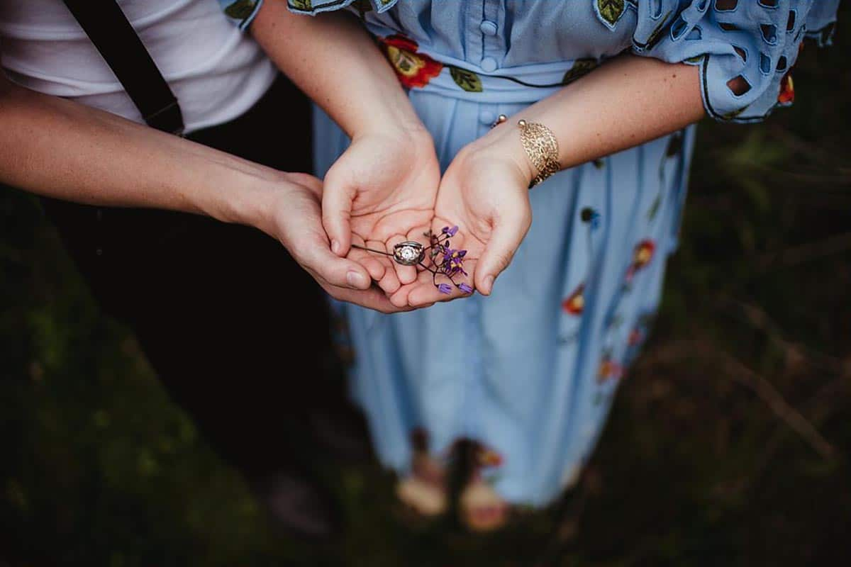 Engagement Couple Holding Rings