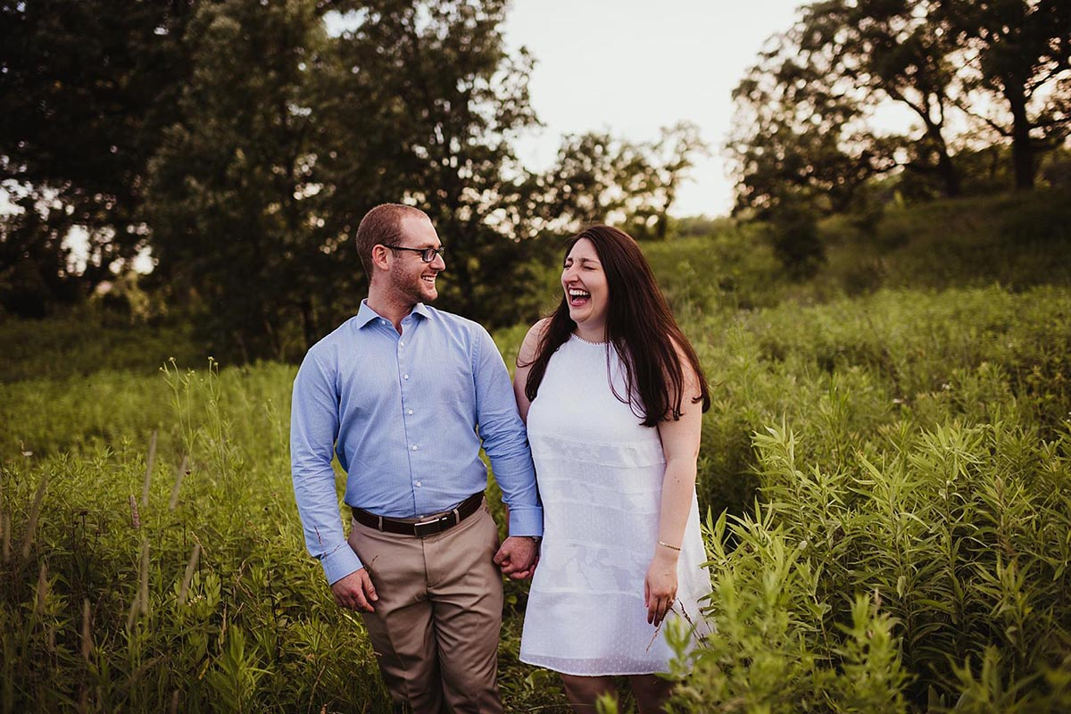 Engagement Couple Laughing in Field