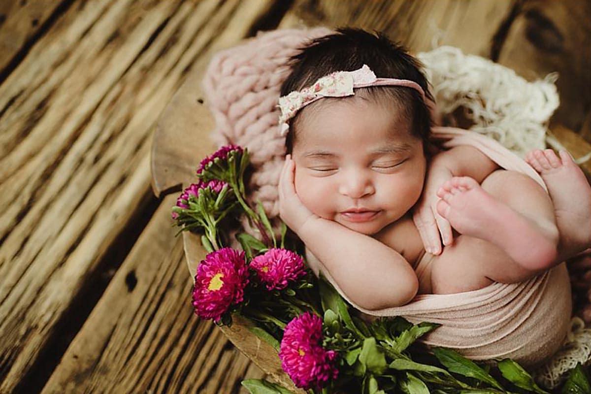 Newborn Girl Smiling Spring Blooms