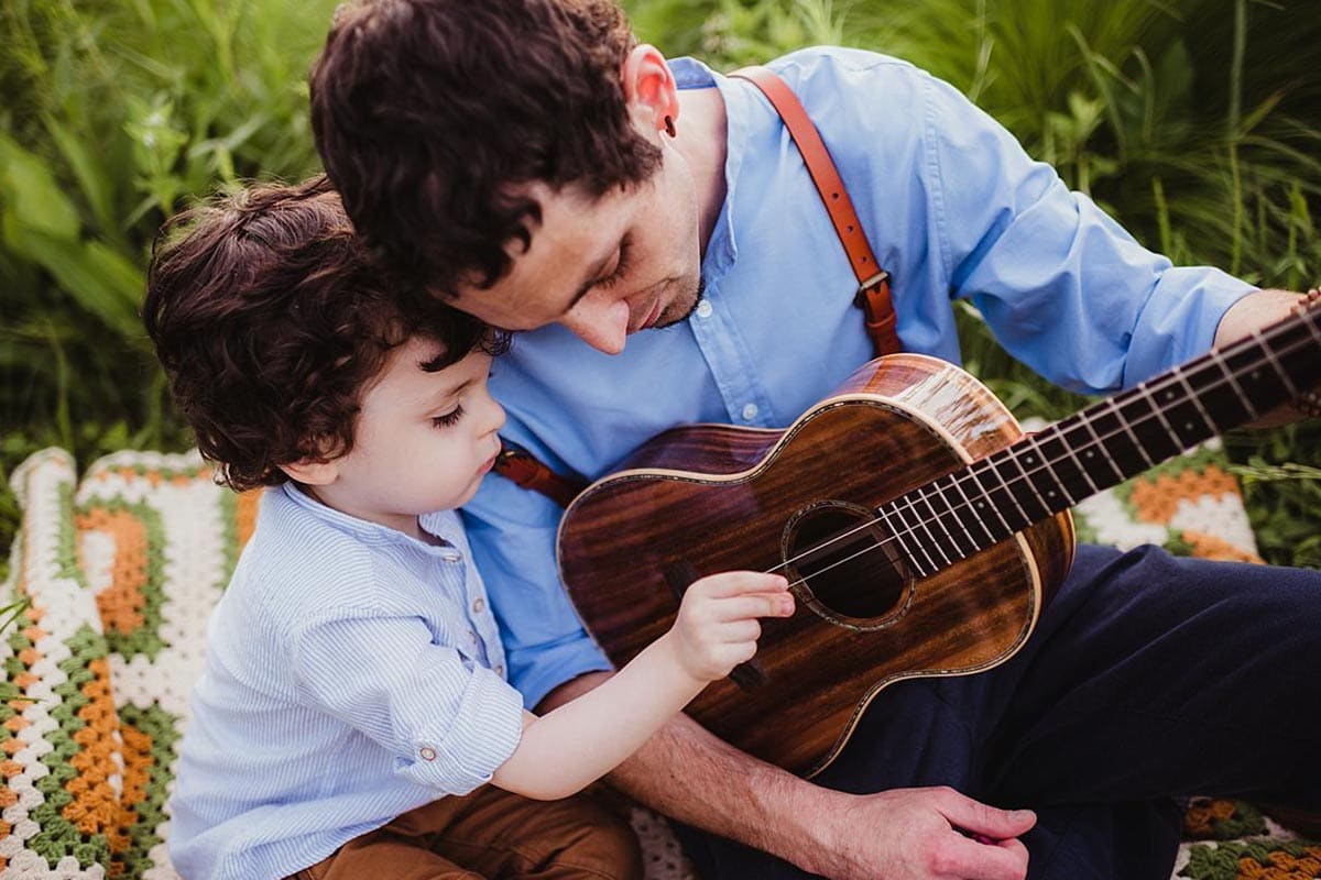 Dad Playing Guitar with Son