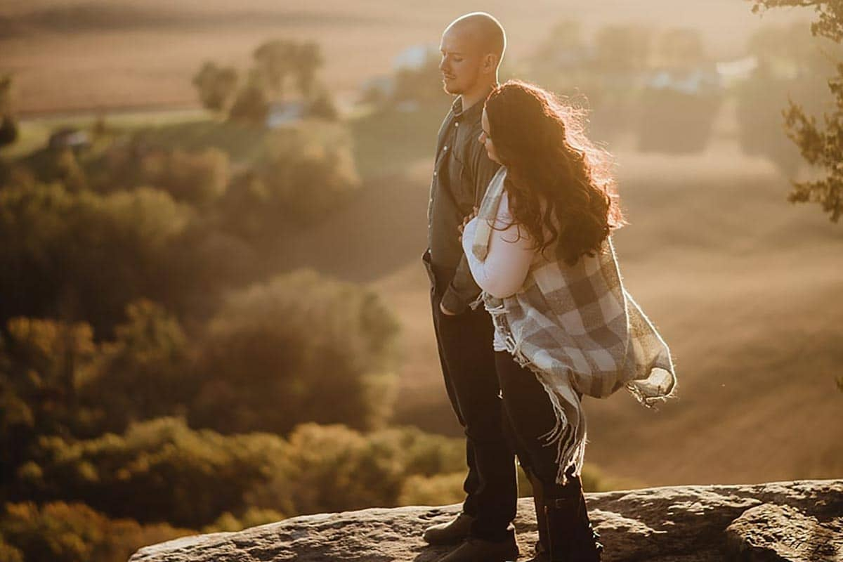 Couple on Clifftop Sunset