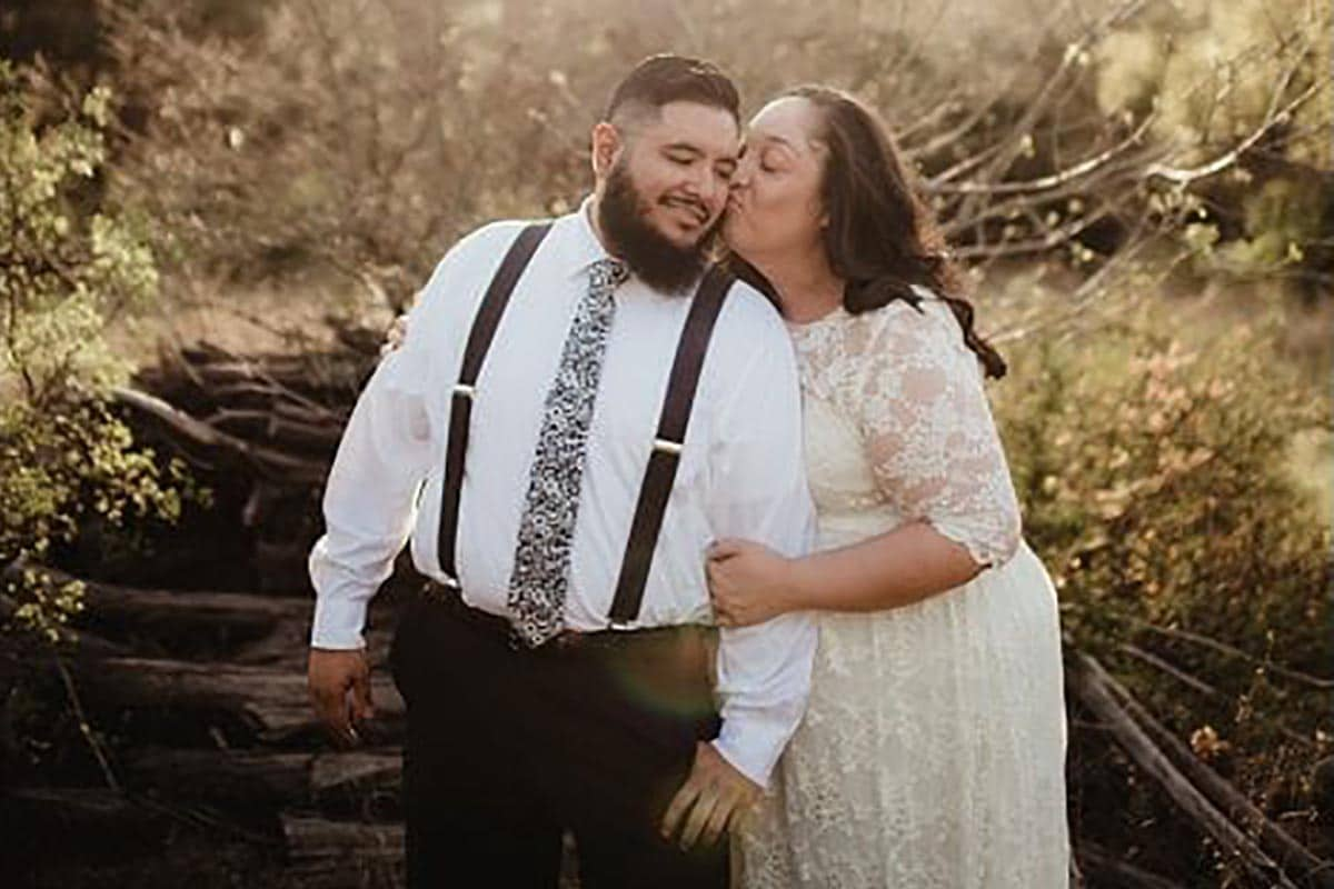 Engagement Woman Kissing Man's Cheek