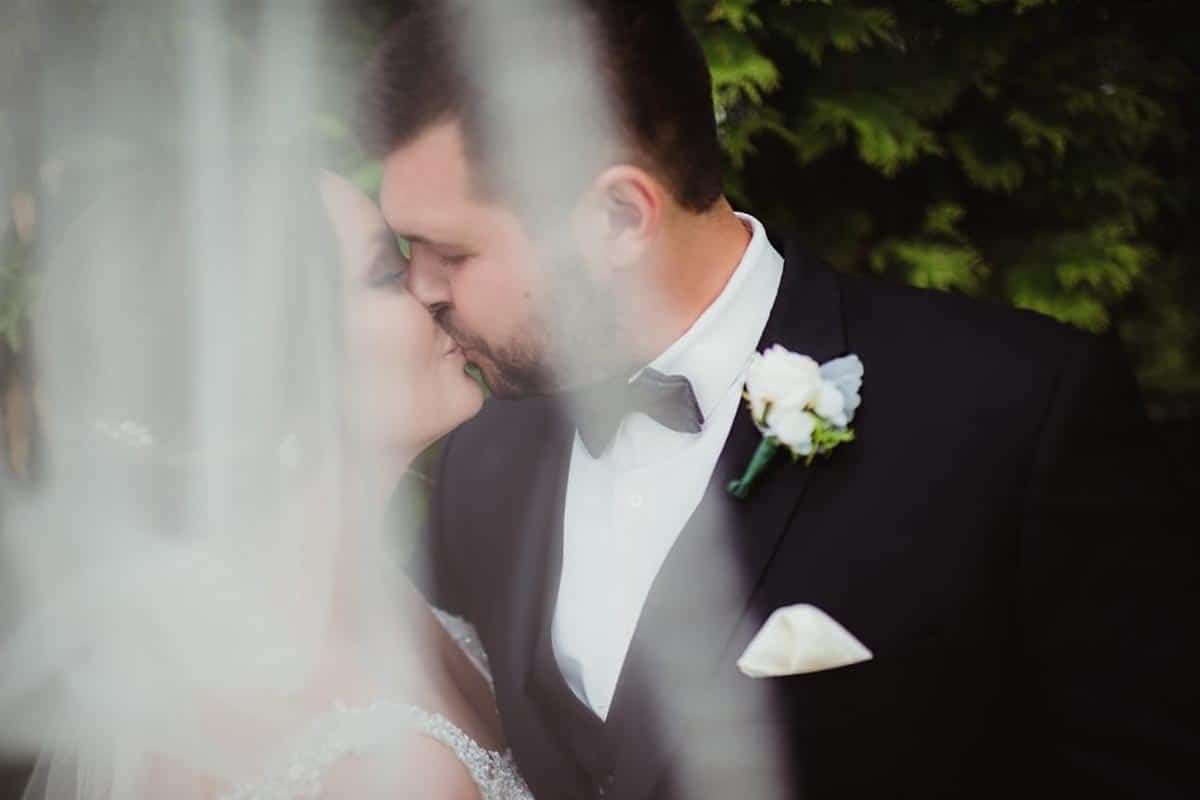 Bride Groom Kiss Through Veil