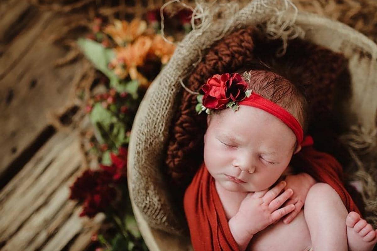 Newborn Girl in Bowl