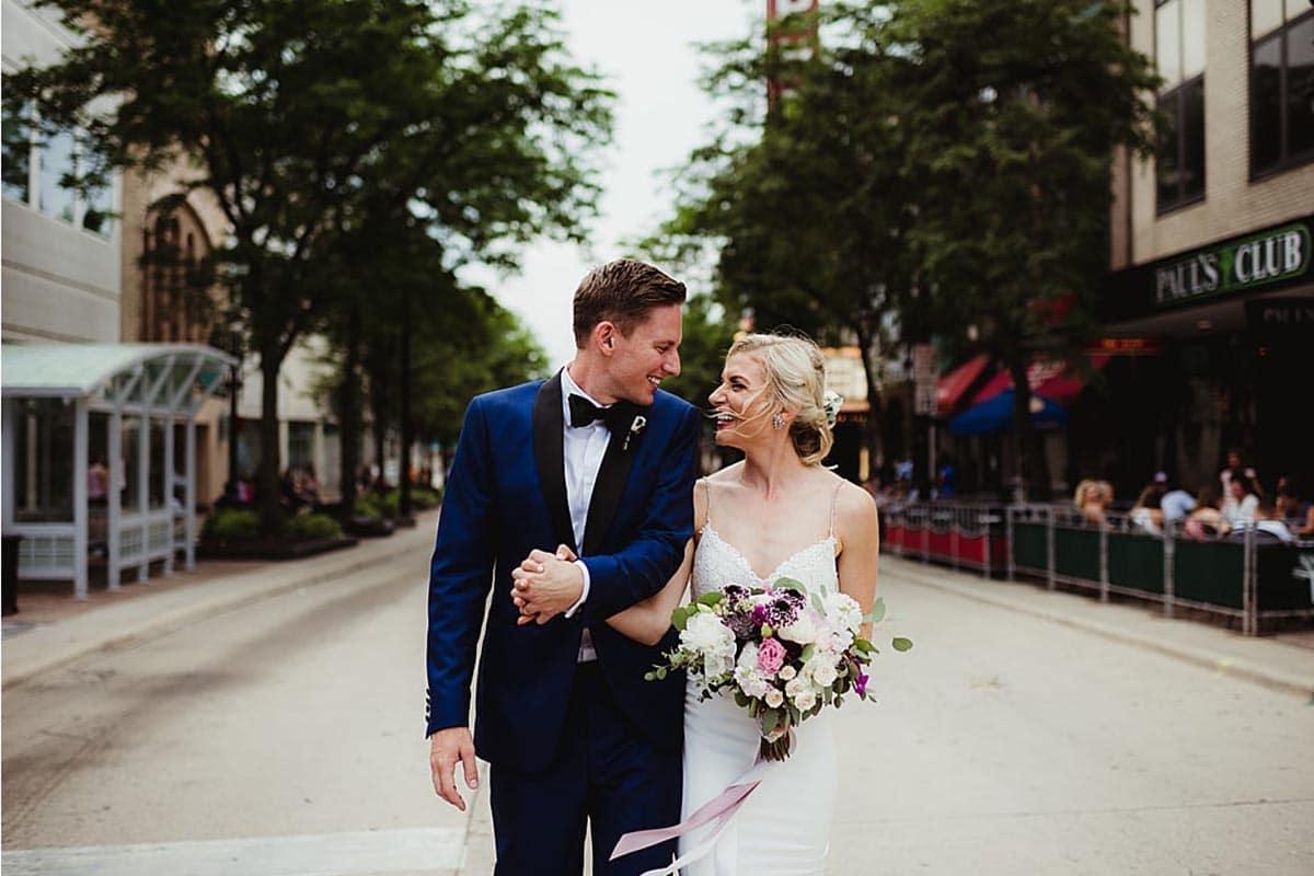Bride and Groom Walking on Street