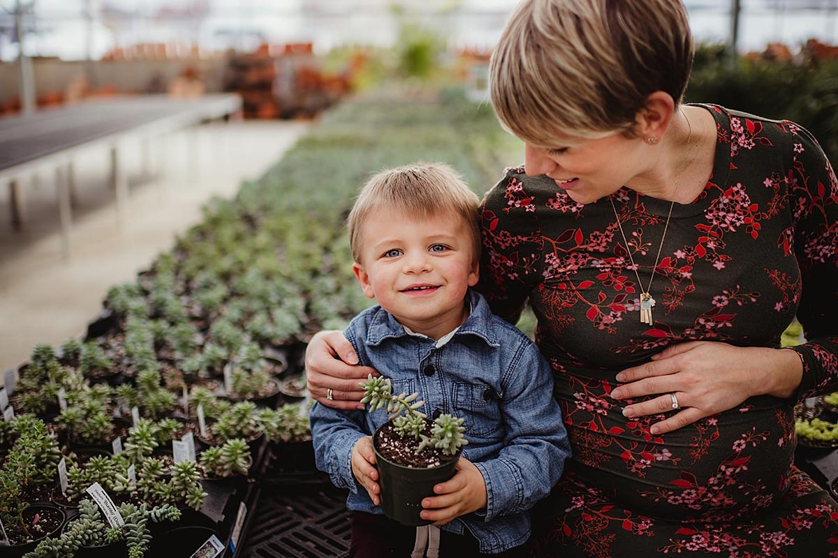Pregnant Mom with Son in Greenhouse