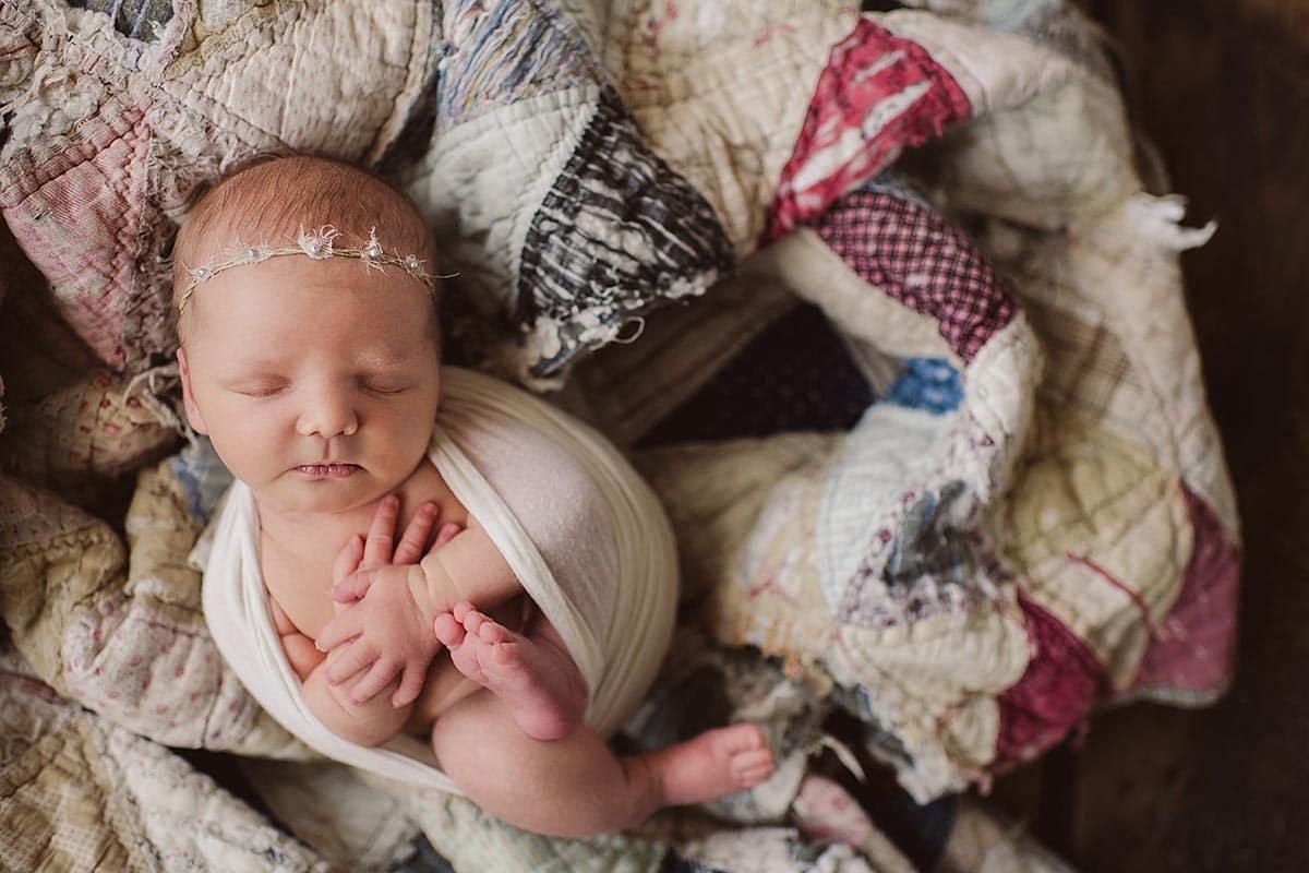 Newborn Girl on Quilt