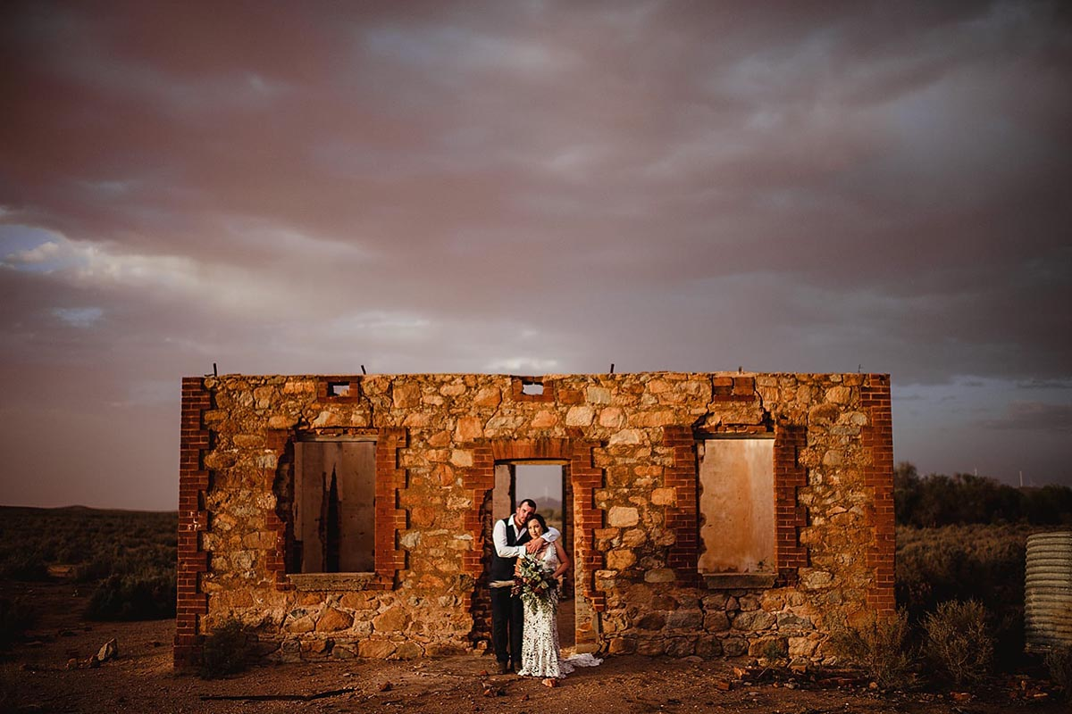 Bride and Groom in Stone Building