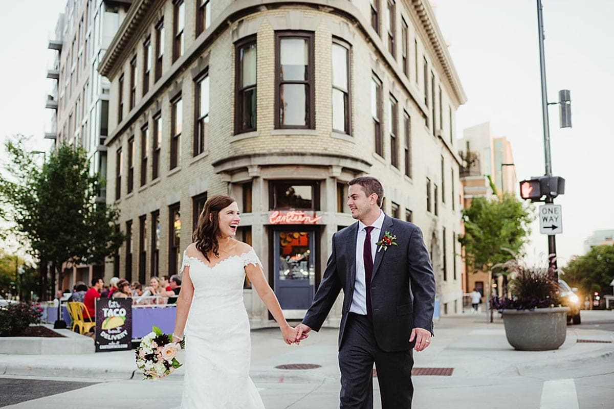 Bride and Groom Holding Hand in Street