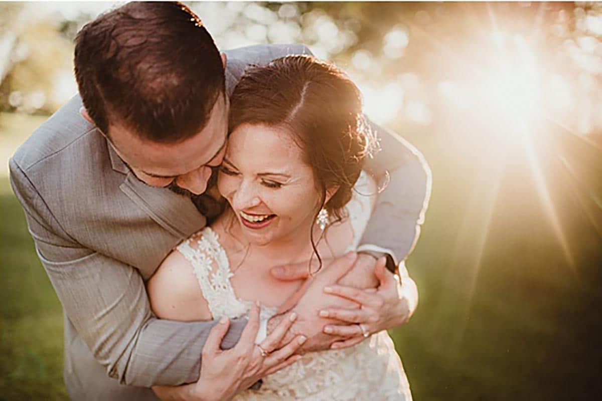 Groom Hugging Laughing Bride