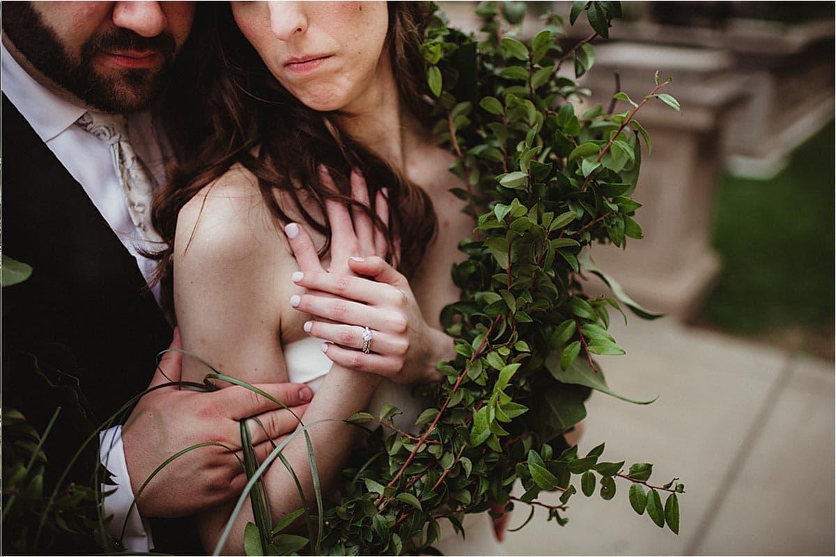 Close Up Groom Holding Bride