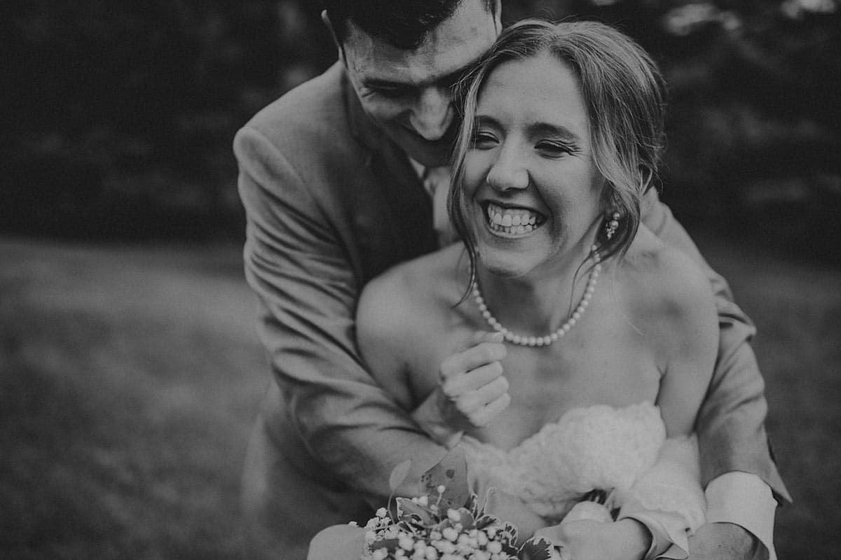Black and White Image Groom Hugging Bride