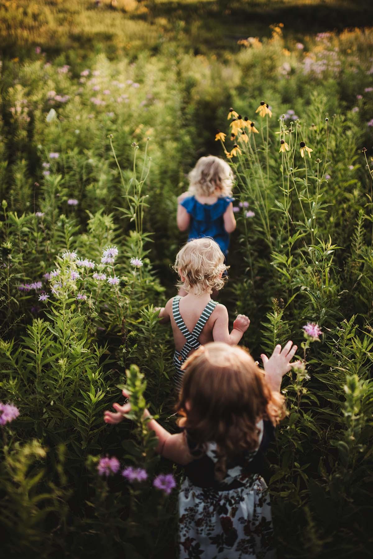 children running in flowers