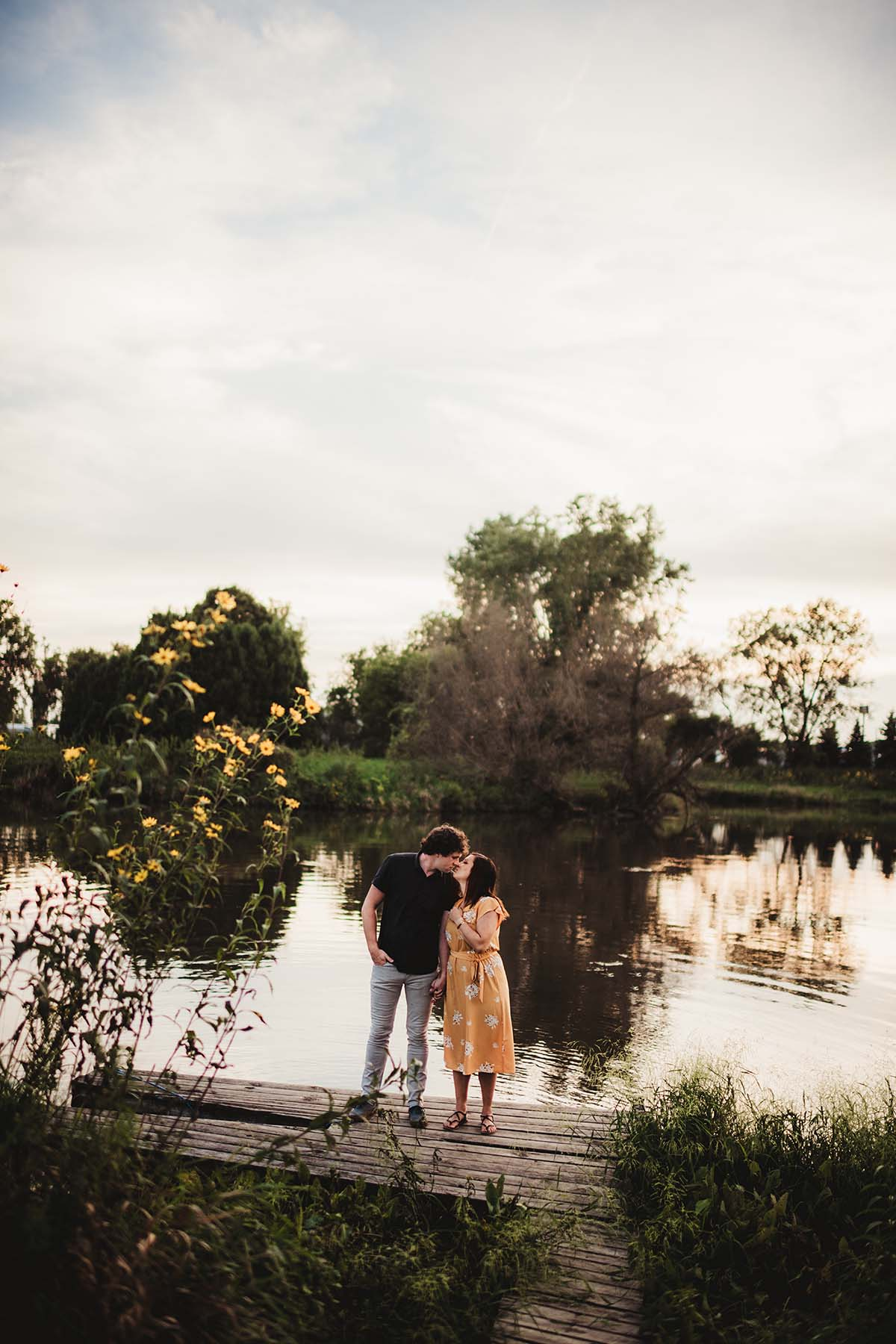couple near a pond at sunset