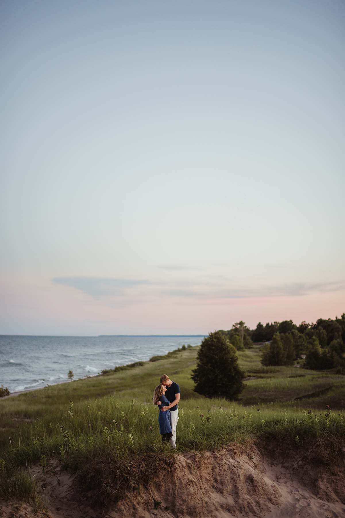 couple near a hilly shore