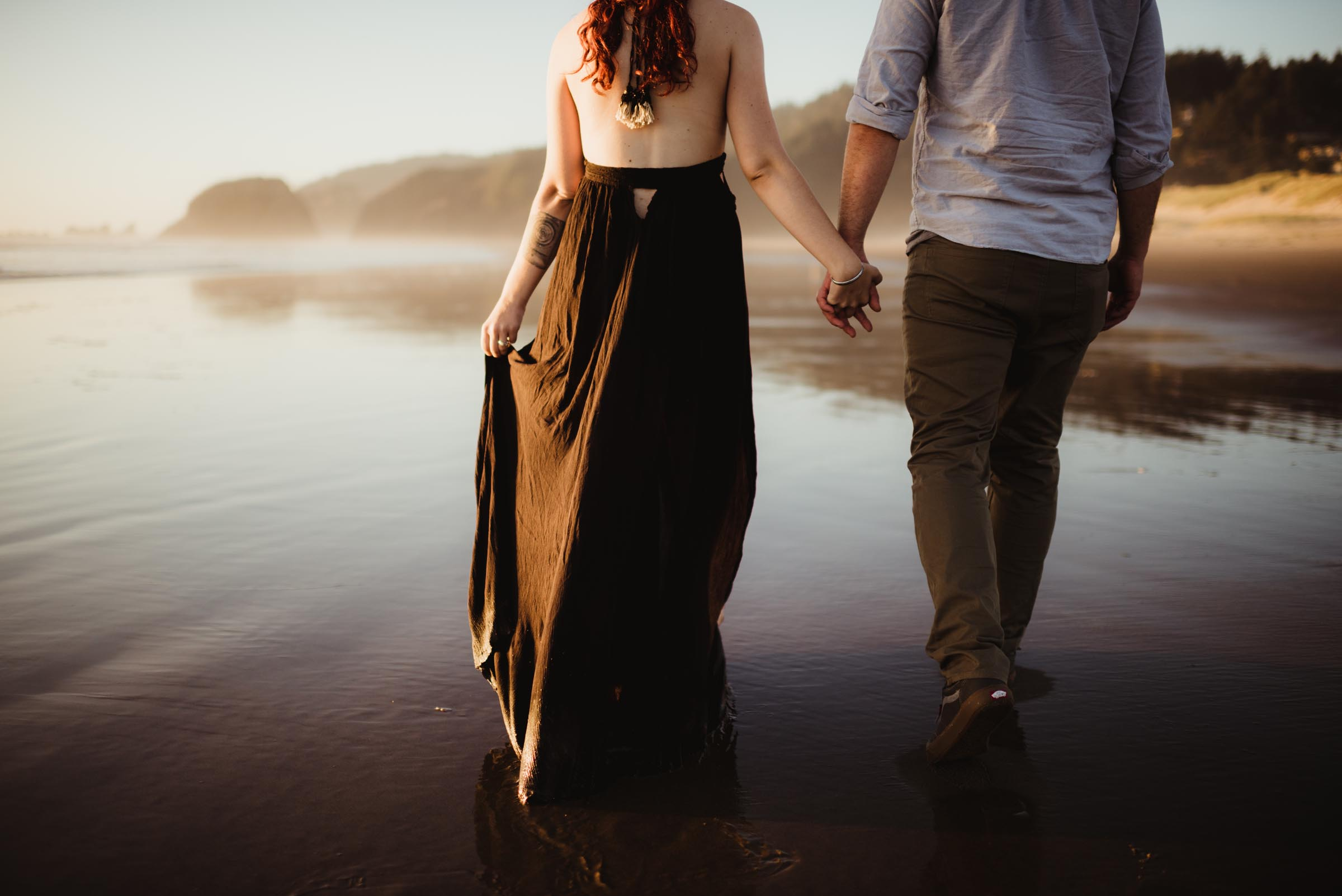 couple walking on the shallow shores in the Pacific Northwest