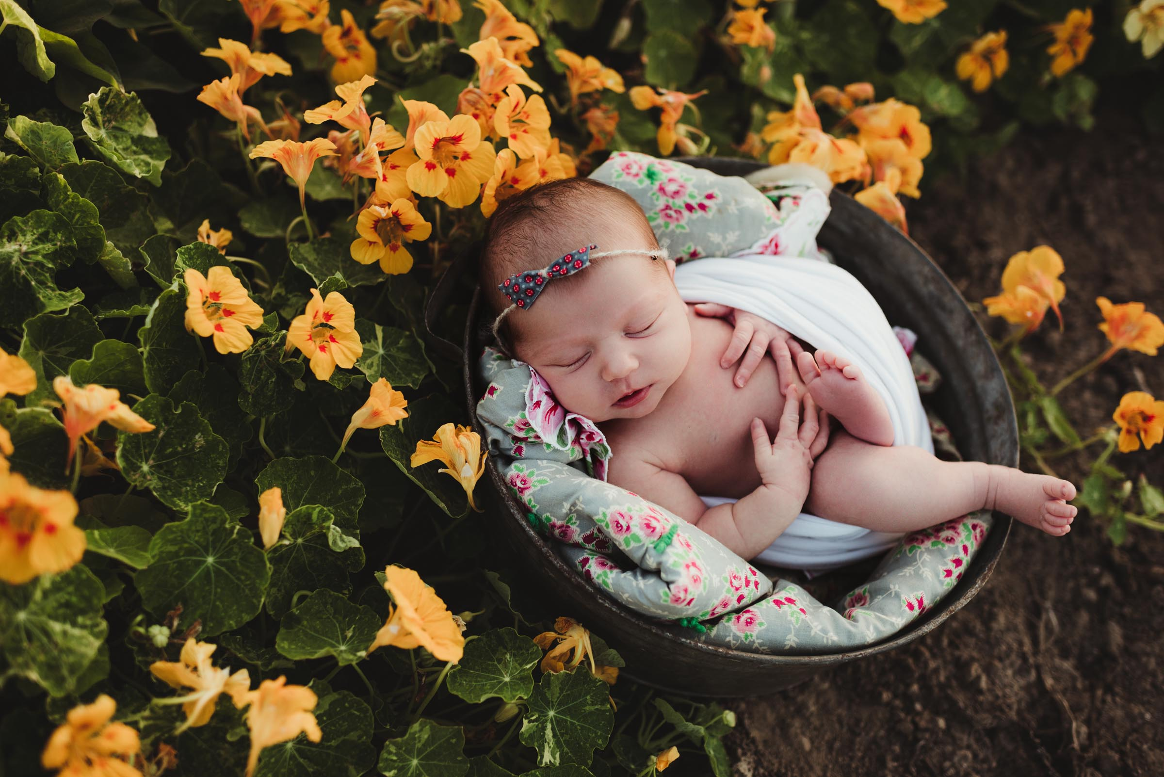 loose baby pose outdoor by yellow flowers