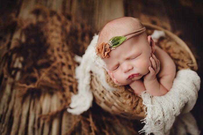baby in gentle froggy pose in studio