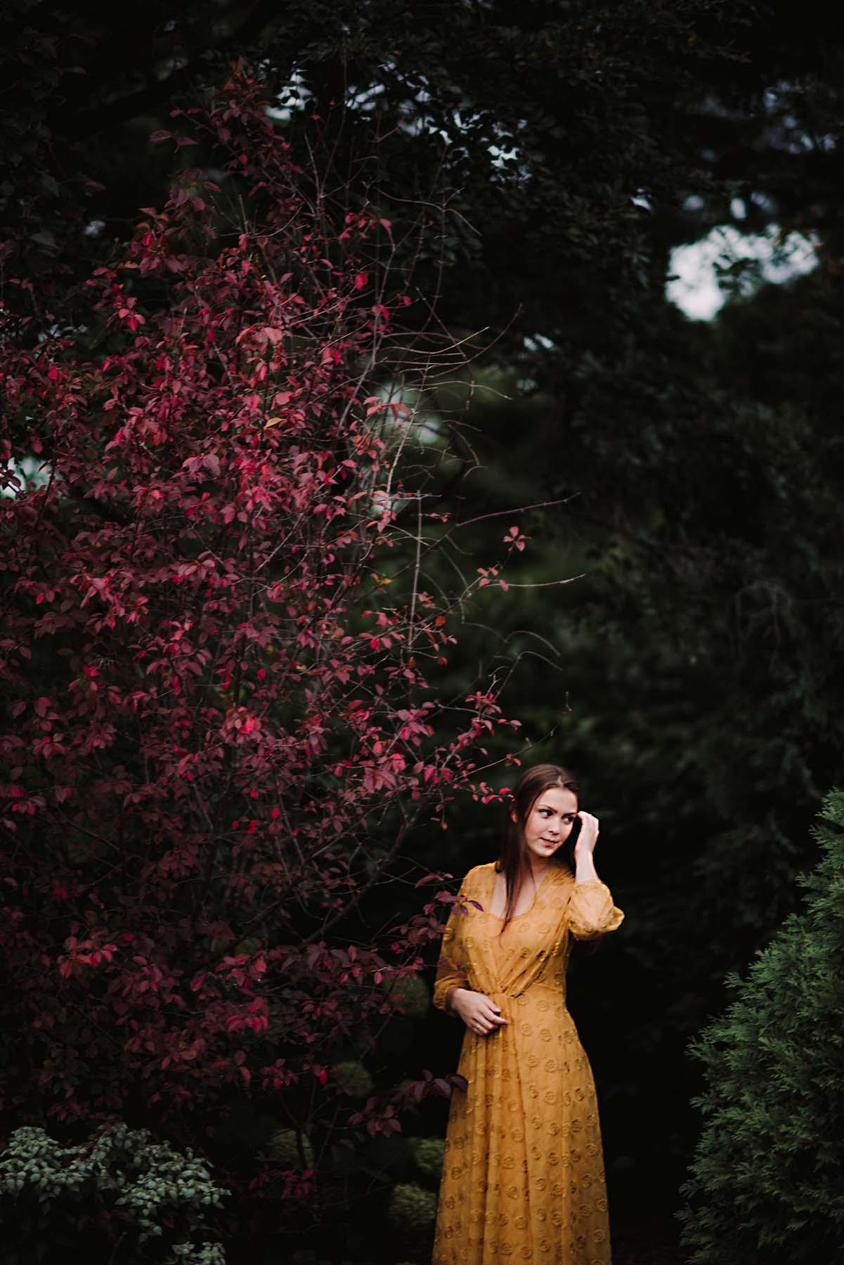 senior girl by flowers