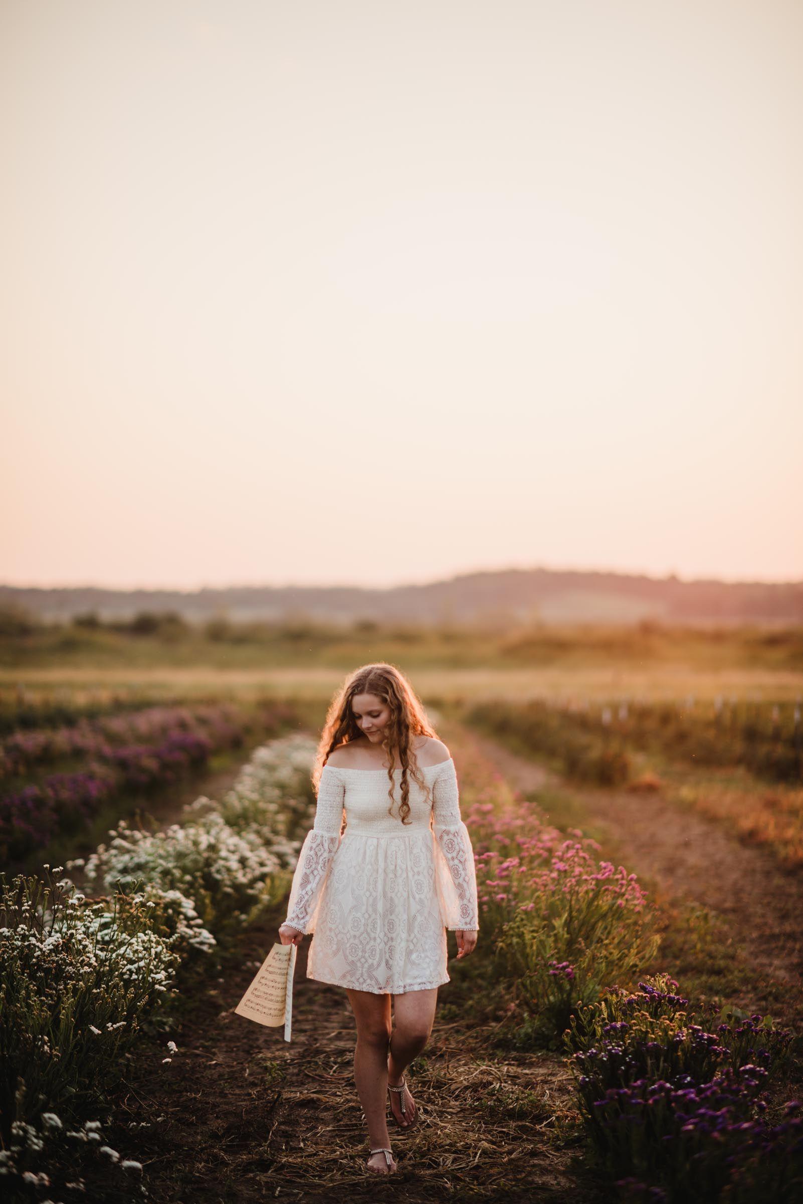 sunset photo with senior girl in white dress