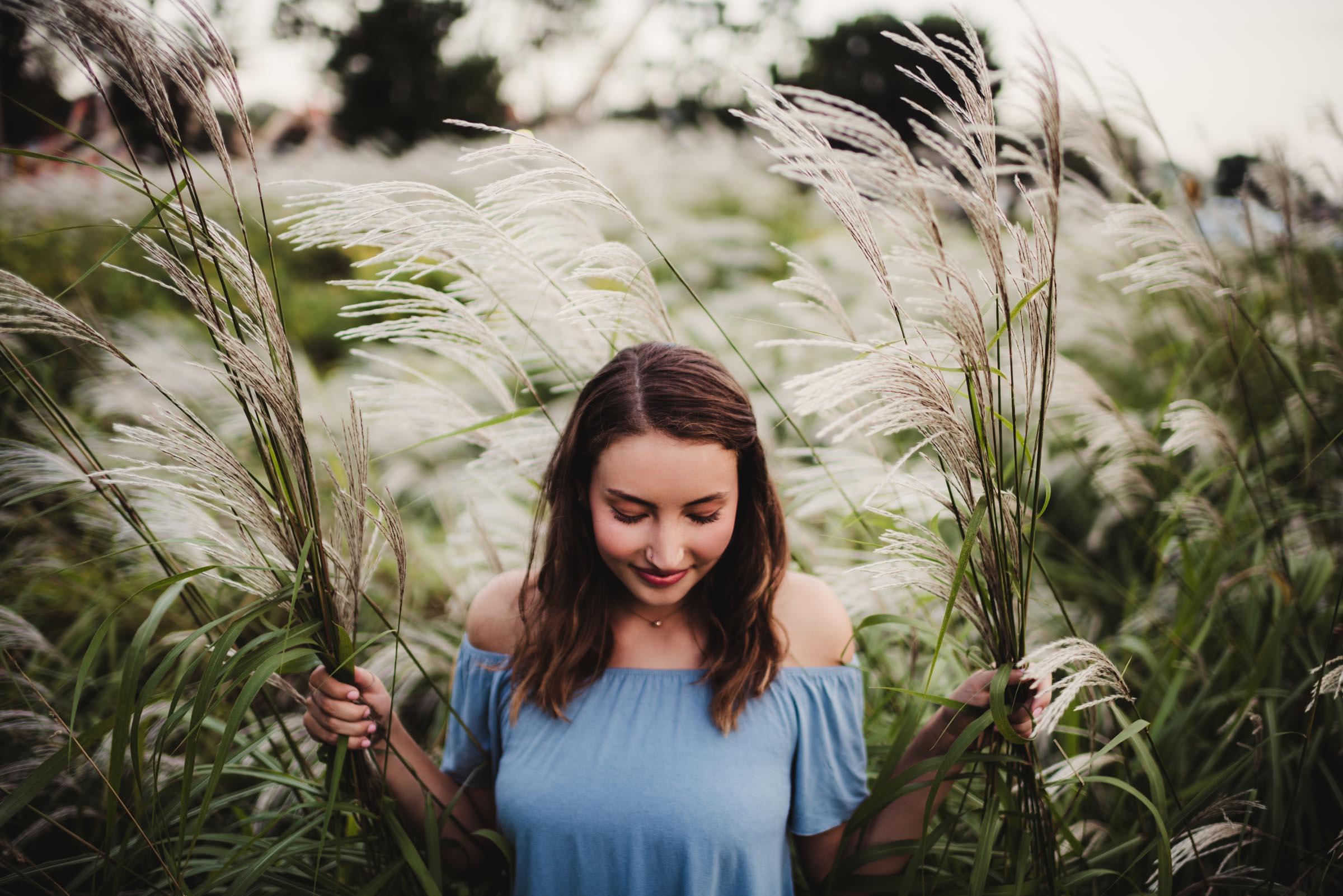 senior girl in field of wheat