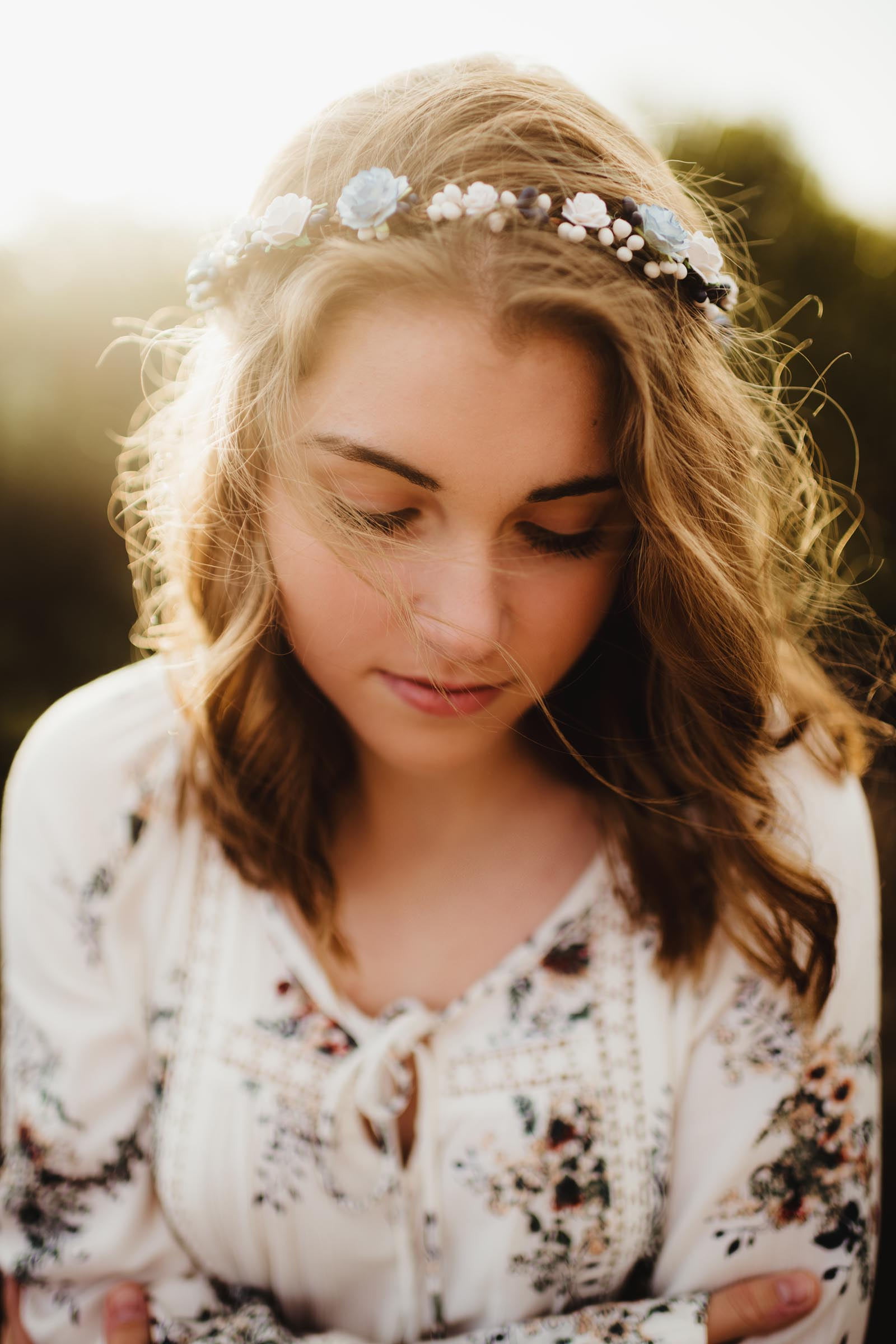floral crown on a senior girl at sunset