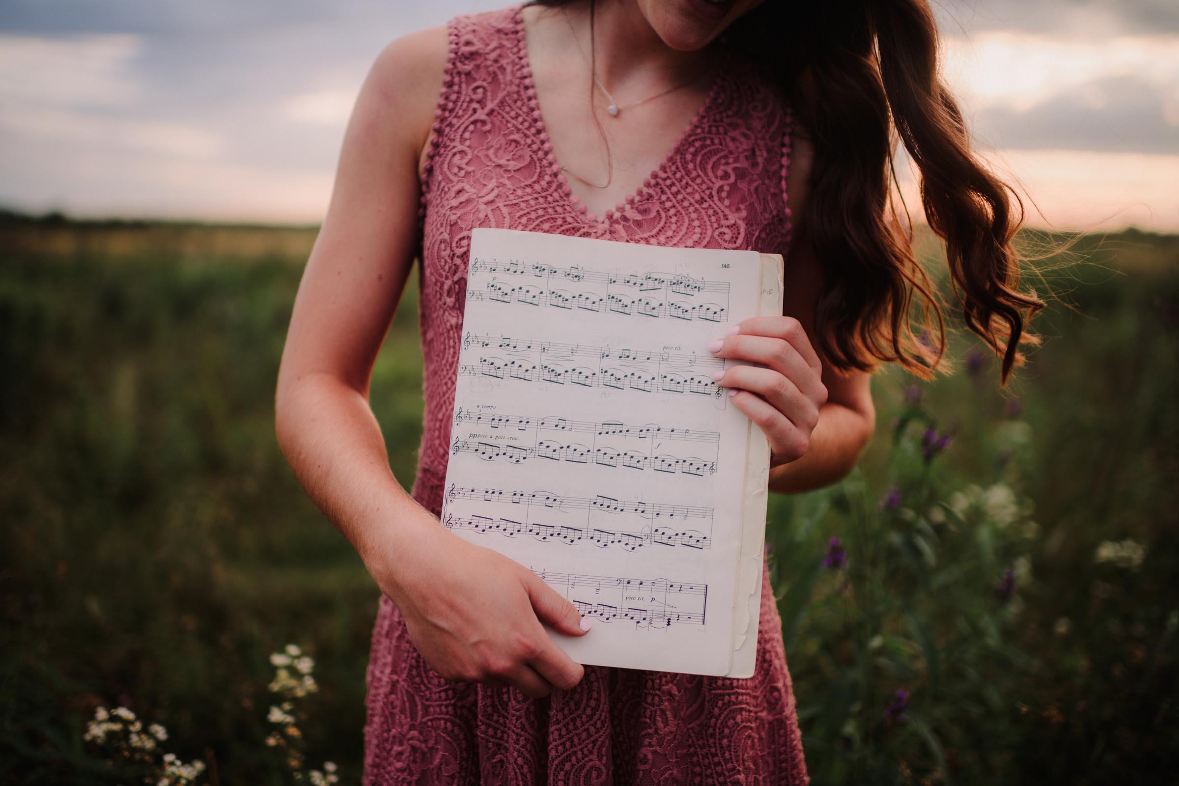 senior girl holding musical notes