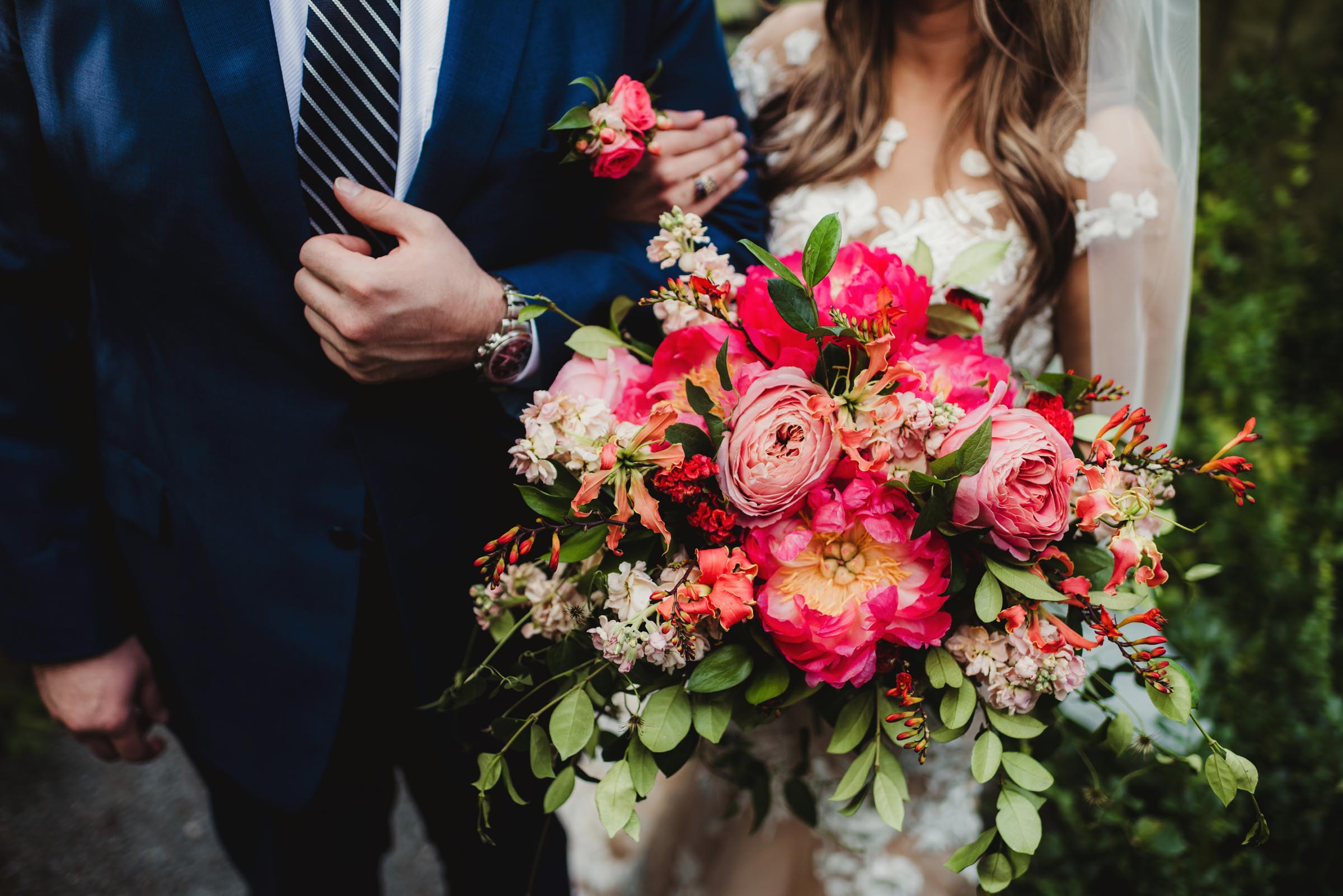 brilliant and bright floral bouquet with couple