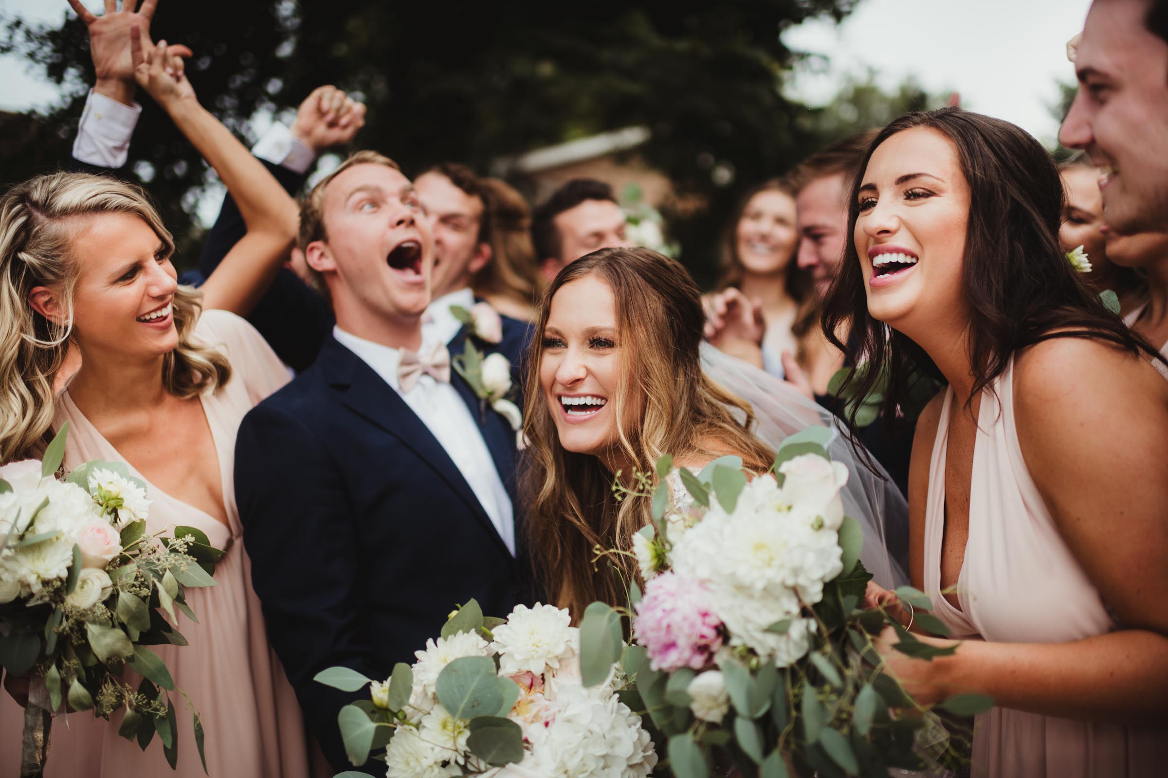 wedding party makes couple laugh