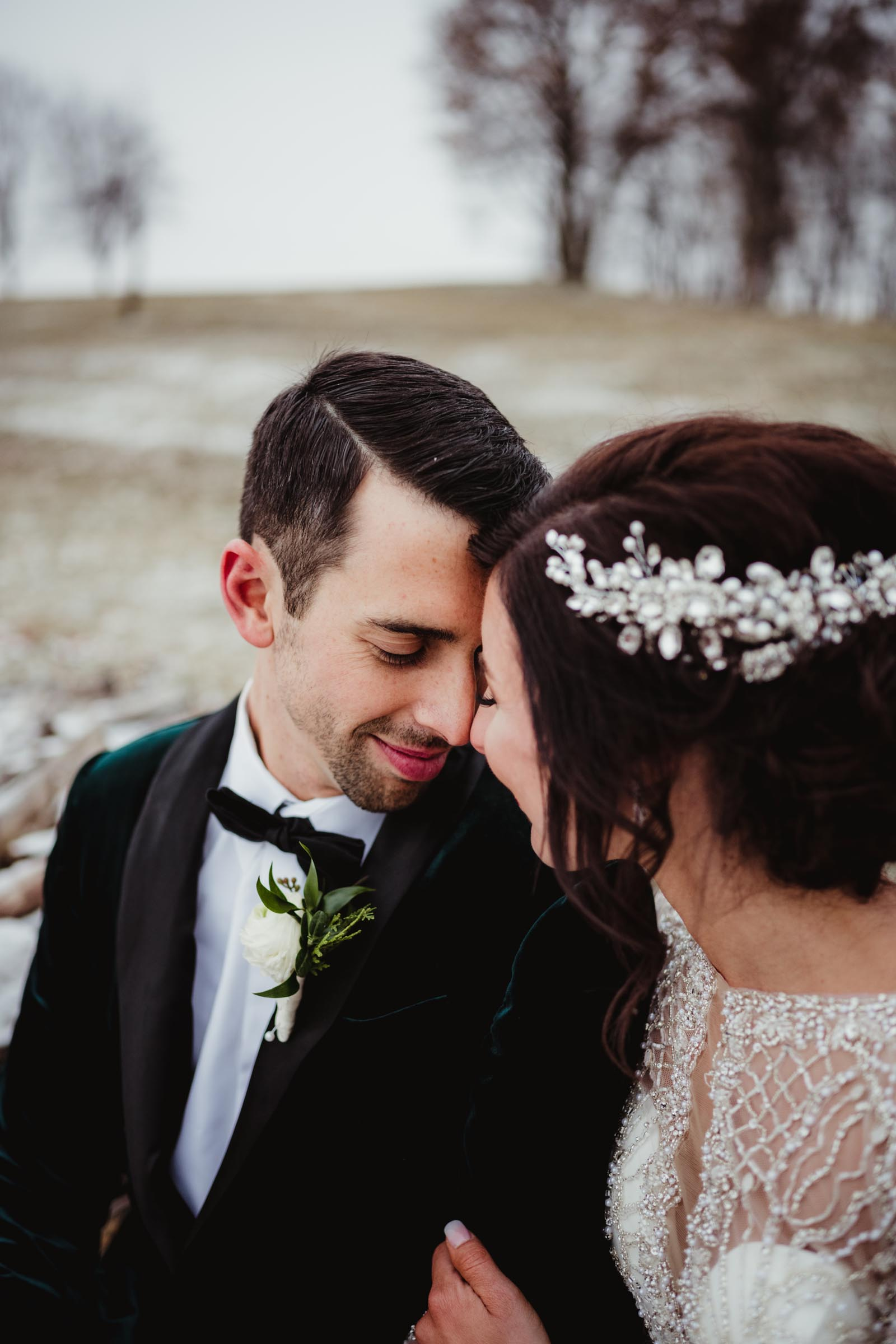 bride with circlet crown with groom in winter