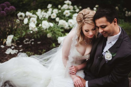 couple affectionately snuggling on wedding day