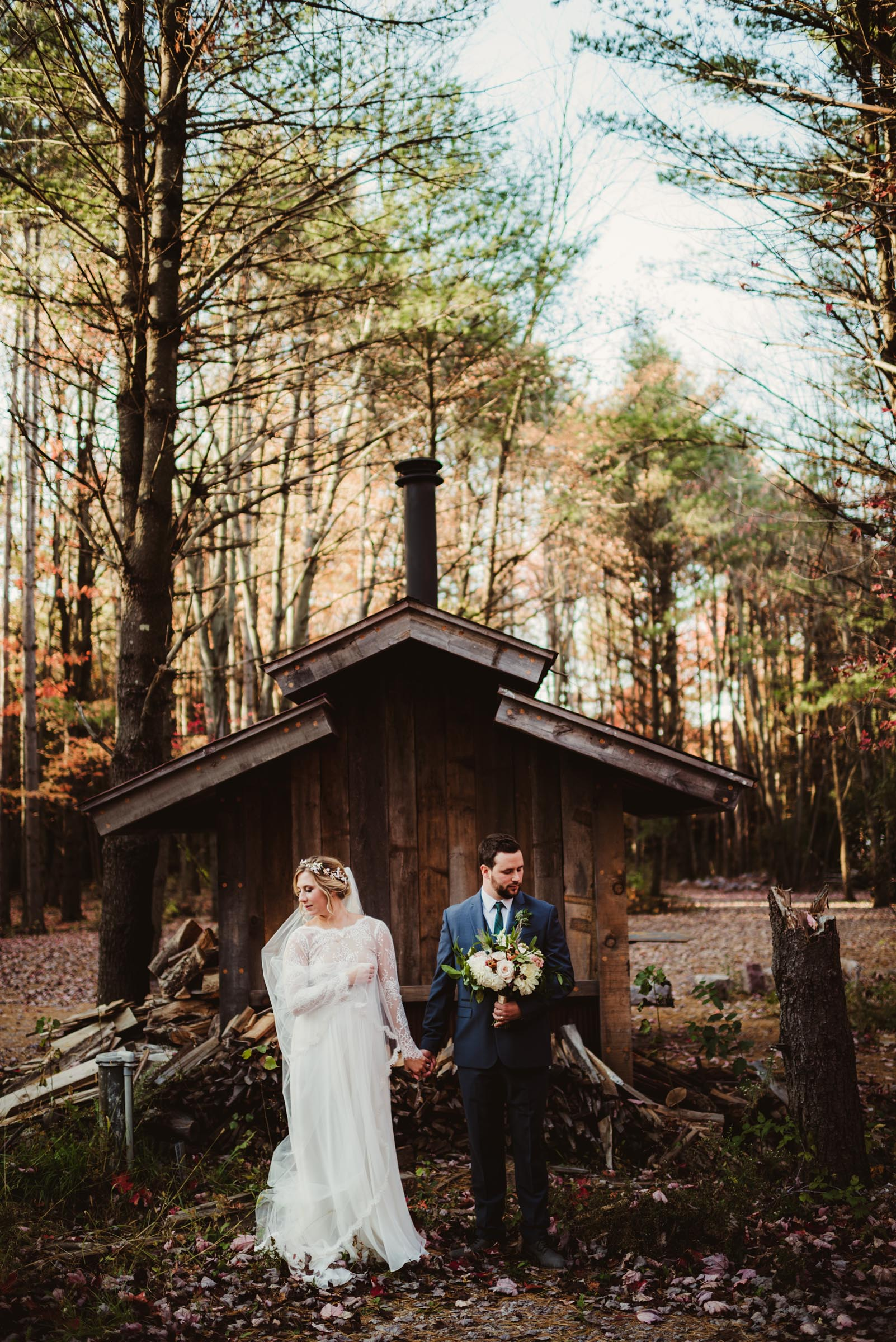 couple in a rustic outdoor setting in fall