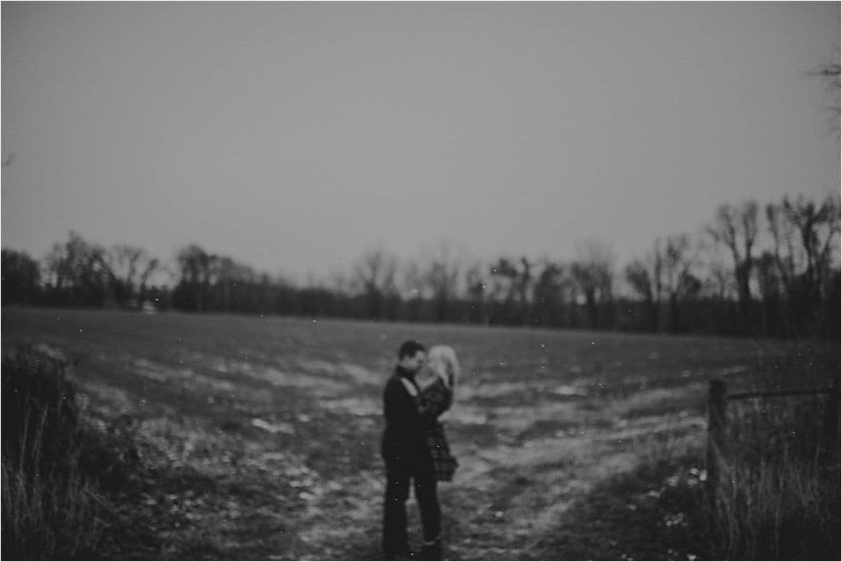 Snowy Engagement Session Couple in Field