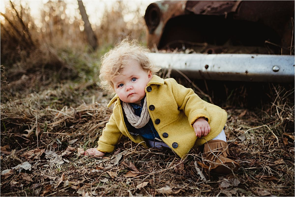 Little Girl Playing By Old Car