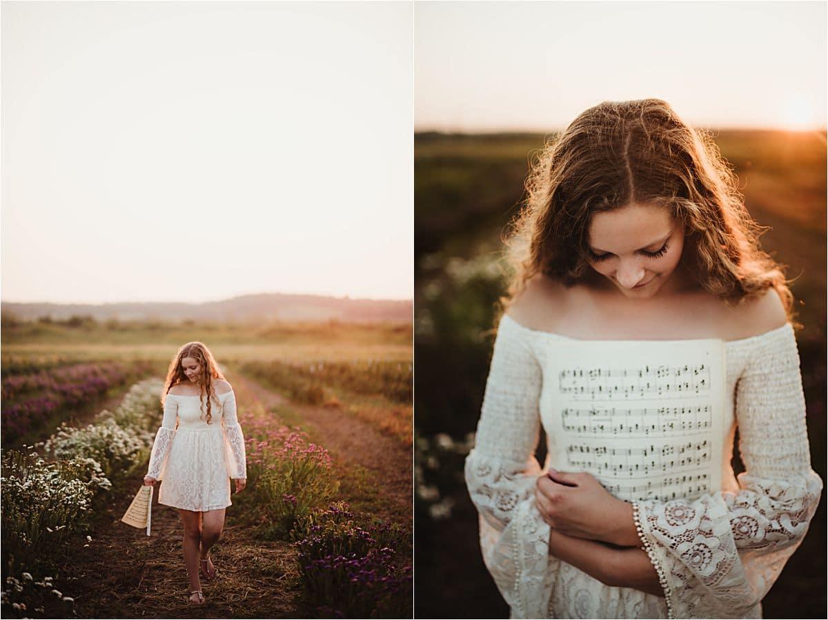 Girl Holding Sheet Music in Field