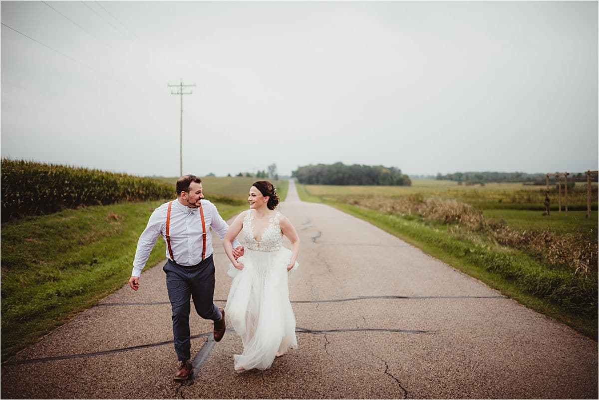 Bride and Groom Running on Road