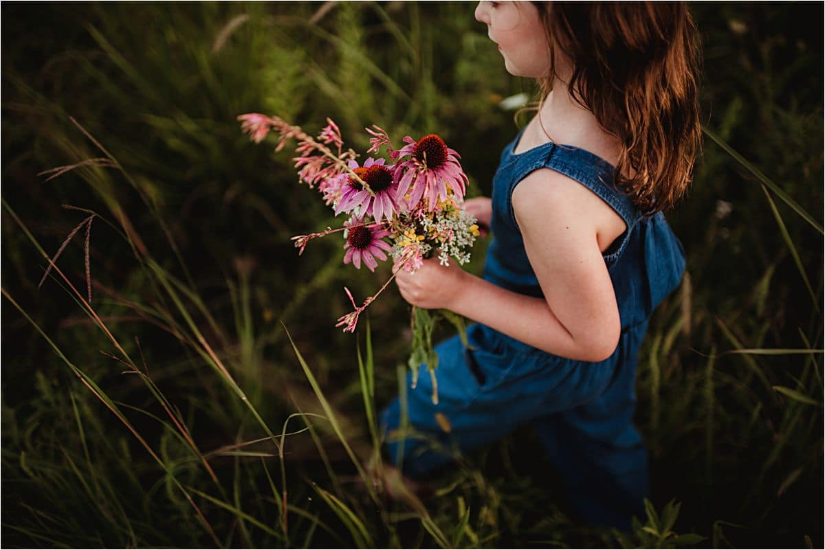 Close Up Little Girl Holding Daisies