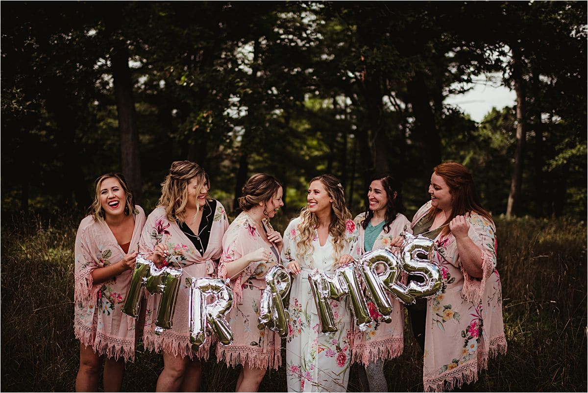 Bride With Bridesmaids Robes Sign